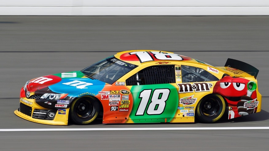 Driver Kyle Busch takes a lap during practice for Sunday's NASCAR Sprint Cup series auto race at Kansas Speedway in Kansas City, Kan., Friday, Oct. 4, 2013. (AP Photo/Colin E. Braley)
