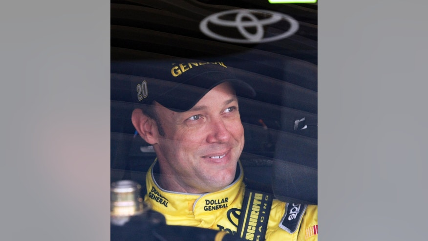 Driver Matt Kenseth sits in his car before practice for Sunday's NASCAR Sprint Cup series auto race at Kansas Speedway Friday, Oct. 4, 2013, in Kansas City, Kan. (AP Photo/Colin E. Braley)