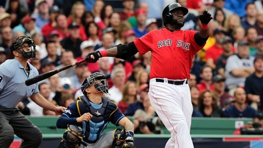Boston Red Sox designated hitter David Ortiz, right, watches his ground rule double in front of Tampa Bay Rays catcher Jose Lobaton in the fourth inning in Game 1 of baseball's American League division series, Friday, Oct. 4, 2013, in Boston. (AP Photo/Charles Krupa)