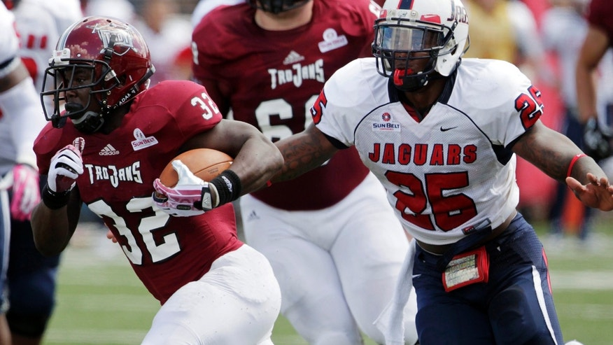 Troy running back Brandon Burks (32) runs past South Alabama linebacker Clifton Crews (25) during an NCAA college football game in Troy, Ala., Saturday, Oct. 5, 2013. (AP Photo/Jay Sailors)