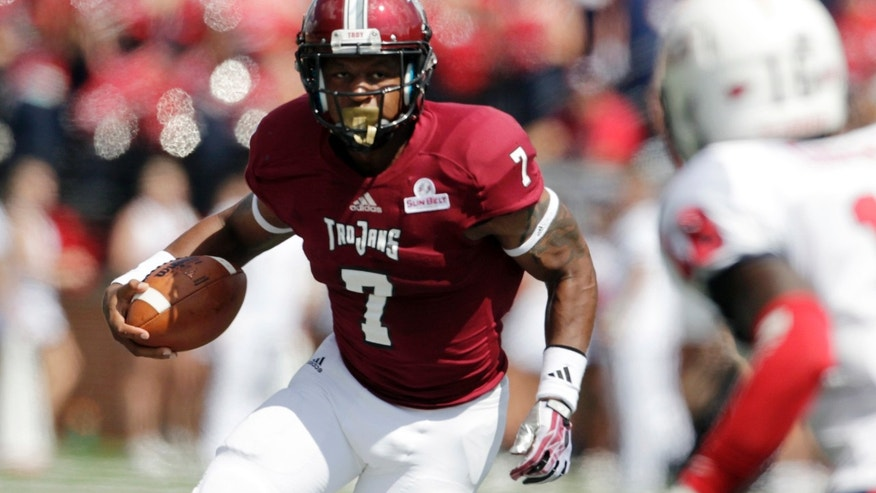 Troy quarterback Deon Anthony (7) looks for yardage against South Alabama during the first half of an NCAA college football game in Troy, Ala., Saturday, Oct. 5, 2013. (AP Photo/Jay Sailors)