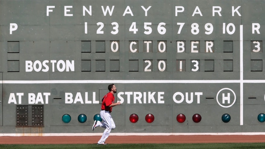 Boston Red Sox starting pitcher John Lackey runs during a baseball practice at Fenway Park, Thursday, Oct. 3, 2013, in Boston. The Red Sox will face the Tampa Bay  Rays in Game 1 of the American League Division Series on Friday in Boston. (AP Photo/Charles Krupa)
