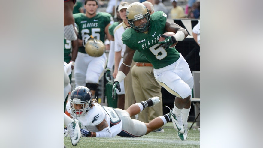 Florida Atlantic defensive back Cre'von LeBlanc watches as UAB running back Darrin Reaves tries to stay inbounds in the first quarter of an NCAA college football game at Legion Field in Birmingham, Ala., Saturday, Oct. 5, 2013. (AP Photo/ AL.com, Mark Almond) MAGS OUT
