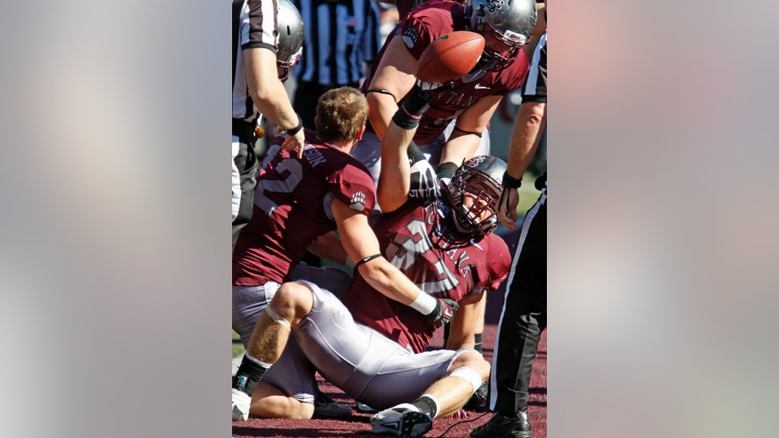 Montana linebacker Jordan Tripp (37) celebrates after recovering a fumble in the end zone for a touchdown in the first quarter against Portland State in an NCAA college football game in Missoula, Mont., Saturday, Oct. 5, 2013. (AP Photo/Michael Albans)