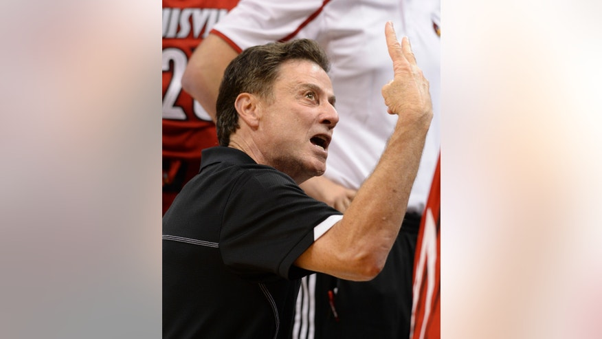 Louisville coach Rick Pitino gives instructions to the red squad during the NCAA college basketball team's scrimmage Saturday, Oct. 5, 2013, in Louisville, Ky. (AP Photo/Timothy D. Easley)