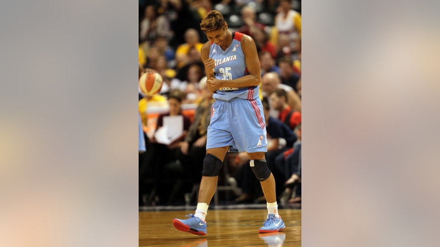 Atlanta's Angel McCoughtry reacts in the closing seconds of the second half of Game 2 of the WNBA basketball Eastern Conference finals game against Indiana on Sunday, Sept. 29, 2013, in Indianapolis. Atlanta won 67-53 to advance to the finals. (AP Photo/AJ Mast)