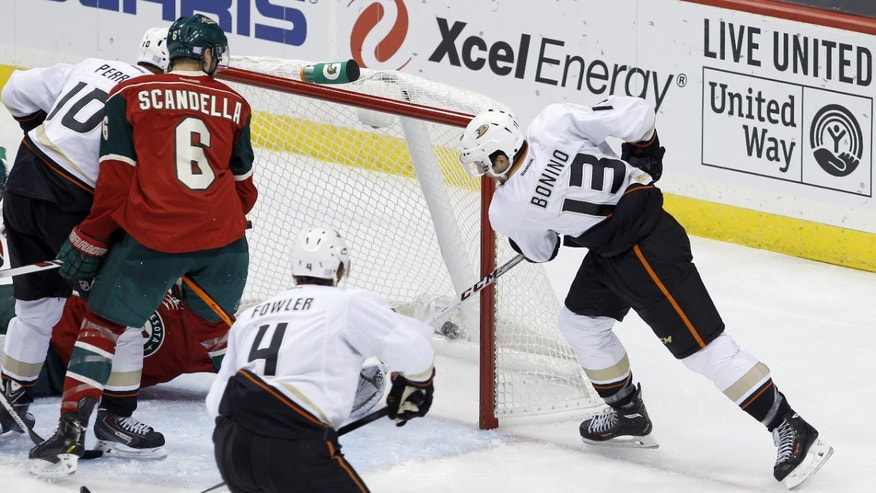Anaheim Ducks center Nick Bonino (13) scores as Minnesota Wild goalie Niklas Backstrom is trapped on the far side of the net during the first period of an NHL hockey game in St. Paul, Minn., Saturday, Oct. 5, 2013. (AP Photo/Ann Heisenfelt)