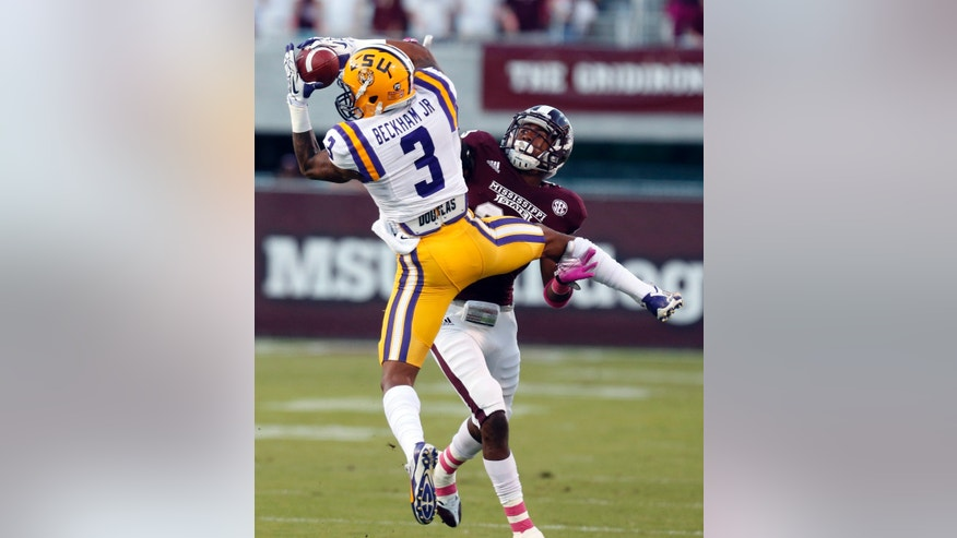 LSU wide receiver Odell Beckham Jr. (3) pulls in a 27-yard pass reception over the defense of Mississippi State defensive back Taveze Calhoun (23) in the first half of their NCAA college football game in Starkville, Miss., Saturday, Oct. 5, 2013.  (AP Photo/Rogelio V. Solis)