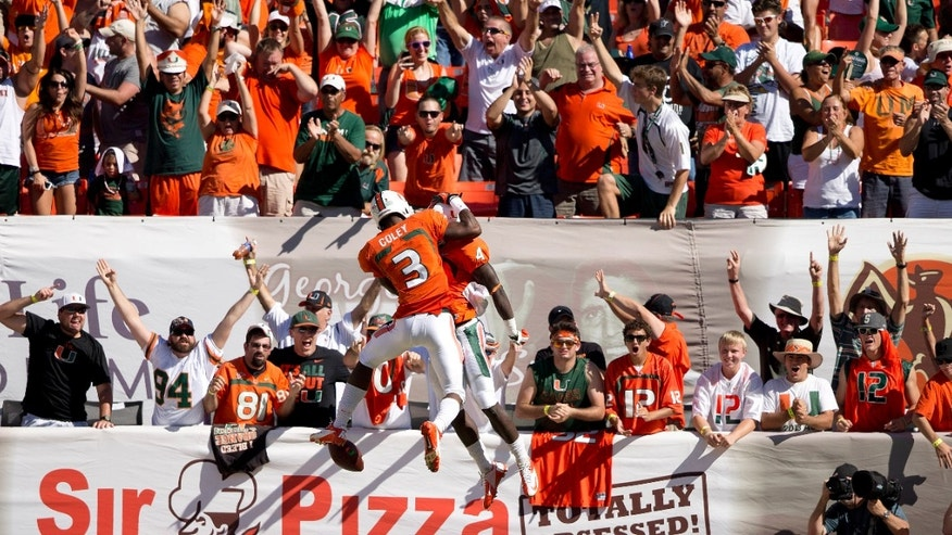 Miami's Stacey Coley (3) and Phillip Dorsett (4) celebrate after Dorsett scored during the first half of an NCAA college football game against Georgia Tech in Miami Gardens, Fla., Saturday, Oct. 5, 2013. (AP Photo/J Pat Carter)