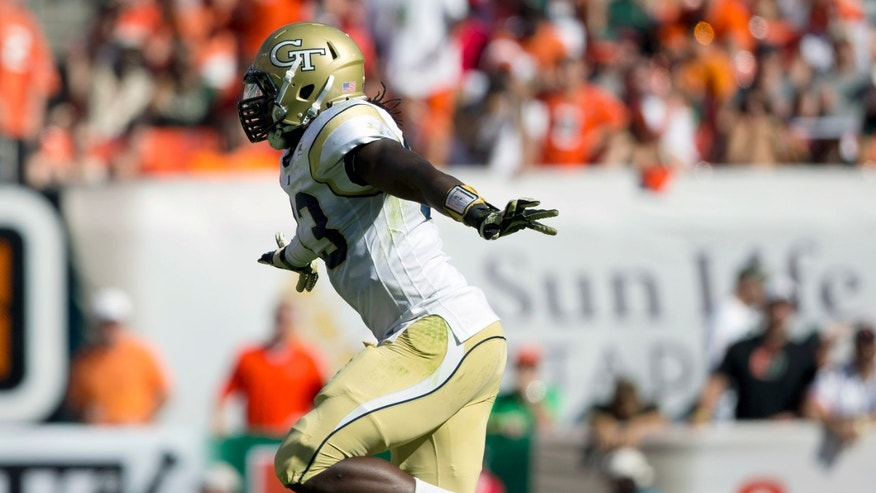 Georgia Tech's Emmanuel Dieke celebrates after his team recovered a fumble by Miami's Duke Johnson during the first half of an NCAA college football game in Miami Gardens, Fla., Saturday, Oct. 5, 2013. (AP Photo/J Pat Carter)