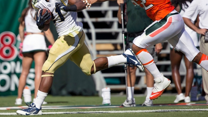 Miami's Kacy Rodgers II, right, tries to stop Georgia Tech's Charles Perkins from scoring a touch down during the first half of an NCAA college football game in Miami Gardens, Fla., Saturday, Oct. 5, 2013. (AP Photo/J Pat Carter)