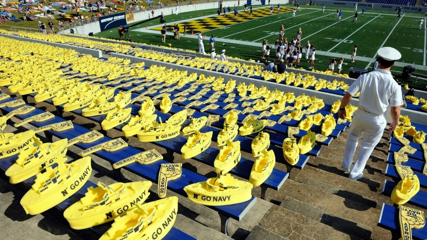 Foam ships and fingers sit lay on the bleachers before the NCAA college football game between Navy and Air Force, Saturday, Oct. 5, 2013, in Annapolis, Md. (AP Photo/Nick Wass)