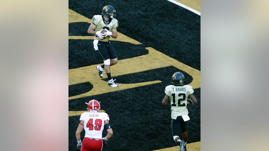 Wake Forest's Michael Campanaro, top, catches a touchdown pass as teammate Tyree Harris, bottom right, and North Carolina State's Zach Gentry watch in the first half of an NCAA college football game in Winston-Salem, N.C., Saturday, Oct. 5, 2013. (AP Photo/Chuck Burton)