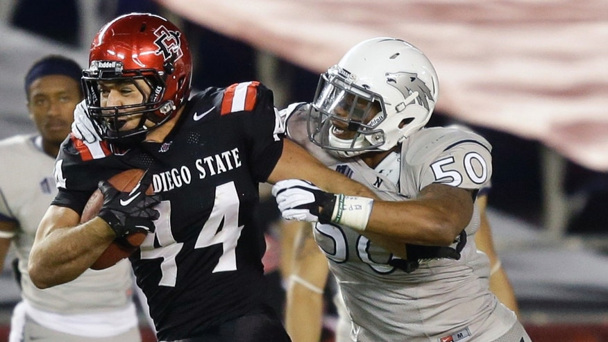 San Diego State tight end Adam Roberts (44) is caught by Nevada linebacker Jonathan McNeal on a 36-yard pass reception during the second quarter of an NCAA college football game on Friday, Oct. 4, 2013, in San Diego. (AP Photo/Lenny Ignelzi)