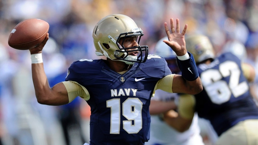 Navy quarterback Keenan Reynolds (19) looks to pass against Air Force during the first half of an NCAA football game, Saturday, Oct. 5, 2013, in Annapolis, Md. (AP Photo/Nick Wass)