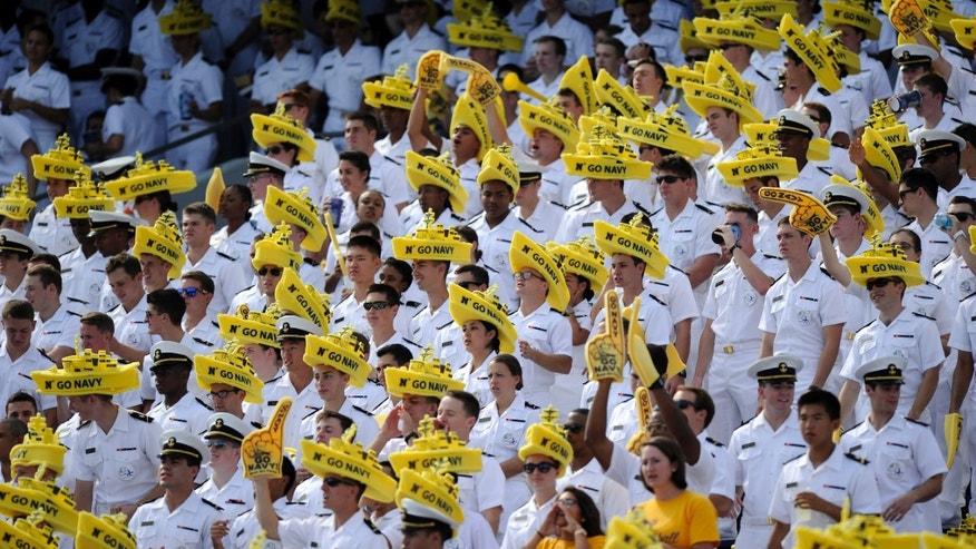 Navy Midshipmen wear foam ships on their heads as they watch Navy against Air Force during the first half of an NCAA football game, Saturday, Oct. 5, 2013, in Annapolis, Md. (AP Photo/Nick Wass)