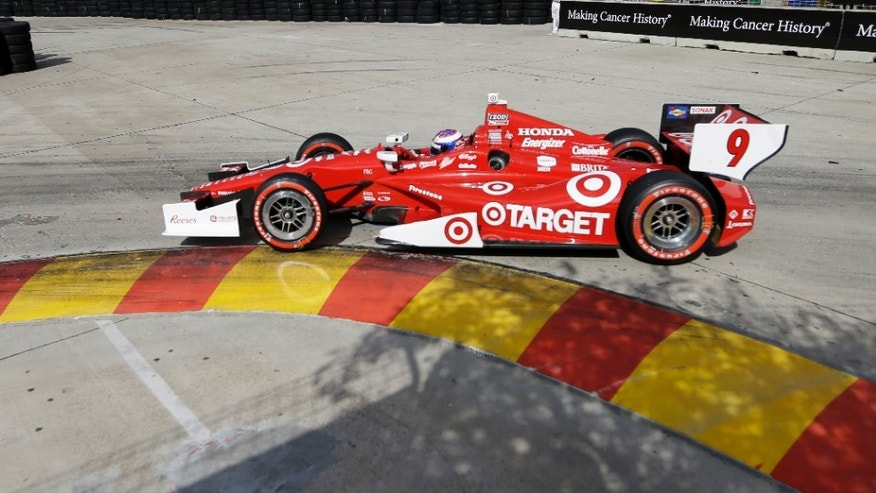 Scott Dixon, of New Zealand, passes through turn three during the first  IndyCar Grand Prix of Houston auto race, Saturday, Oct. 5, 2013, in Houston. (AP Photo/David J. Phillip)