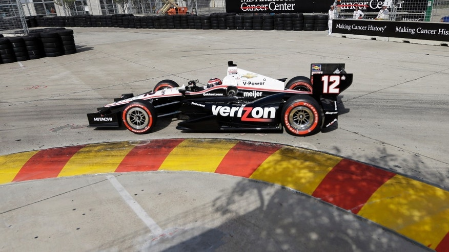 Will Power, of Australia, goes through turn three during the first IndyCar Grand Prix of Houston auto race, Saturday, Oct. 5, 2013, in Houston. (AP Photo/David J. Phillip)