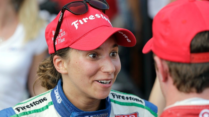 Simona De Silvestro, left, of Switzerland, talks with Scott Dixon, of New Zealand, after the first IndyCar Grand Prix of Houston auto race, Saturday, Oct. 5, 2013, in Houston. De Silvestro finished second, and Dixon finished first. (AP Photo/David J. Phillip)