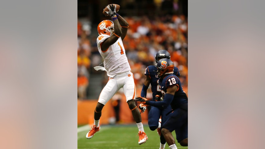 Clemson wide receiver Martavis Bryant (1) makes a catch in front of Syracuse defensive back Darius Kelly (18) during the first half of an NCAA college football game on Saturday, Oct. 5, 2013, in Syracuse, N.Y. (AP Photo/Mike Groll)