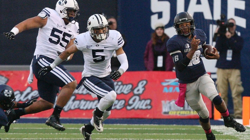 Utah State quarterback Chuckie Keeton (16) runs during an NCAA college football game against Brigham Young on Friday, Oct. 4, 2013, in Logan, Utah. The Cougars won 31-7. (AP Photo/The Salt Lake Tribune, Leah Hogsten)