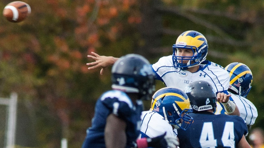 Delaware quarterback Trent Hurley (2) throws during the first half of an NCAA college football game against Maine in Orono, Maine, Saturday, Oct. 5, 2013. (AP Photo/Michael C. York)