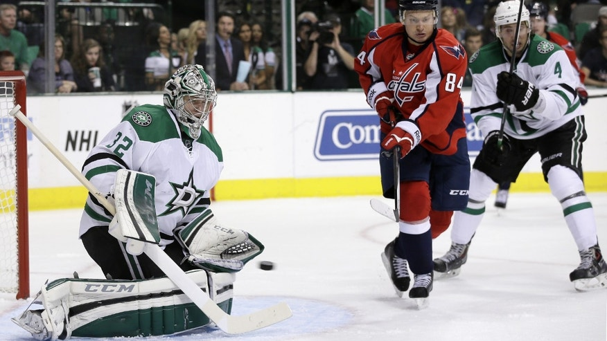 Dallas Stars' Kari Lehtonen (32), of Finland ,defends against a shot as Washington Capitals' Mikhail Grabovski (84) and Stars' Brenden Dillon (4) watch in the second period of an NHL hockey game on Saturday, Oct. 5, 2013, in Dallas. (AP Photo/Tony Gutierrez)