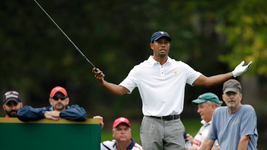 United States team player Tiger Woods reacts before teeing off on the 18th hole during the single matches at the Presidents Cup golf tournament at Muirfield Village Golf Club Sunday, Oct. 6, 2013, in Dublin, Ohio. (AP Photo/Darron Cummings)