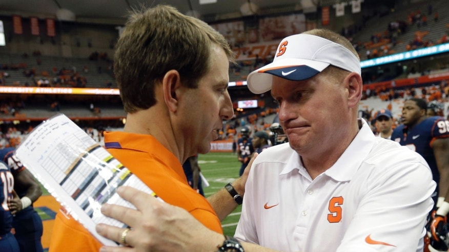 Clemson head coach Dabo Swinney, left, and Syracuse head coach Scott Shafer shakes hands after an NCAA college football game on Saturday, Oct. 5, 2013, in Syracuse, N.Y. Clemson won, 49-14. (AP Photo/Mike Groll)