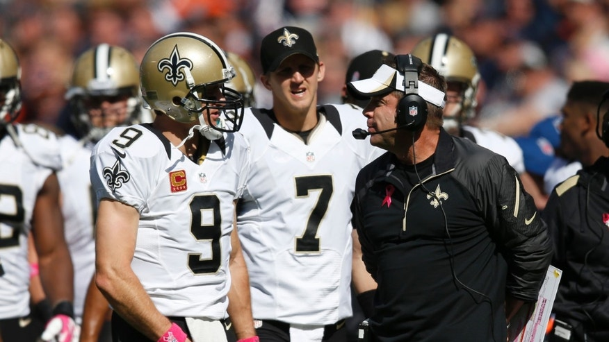 New Orleans Saints quarterback Drew Brees (9) talks to head coach Sean Payton during the first half of an NFL football game against the Chicago Bears, Sunday, Oct. 6, 2013, in Chicago.(AP Photo/Charles Rex Arbogast)