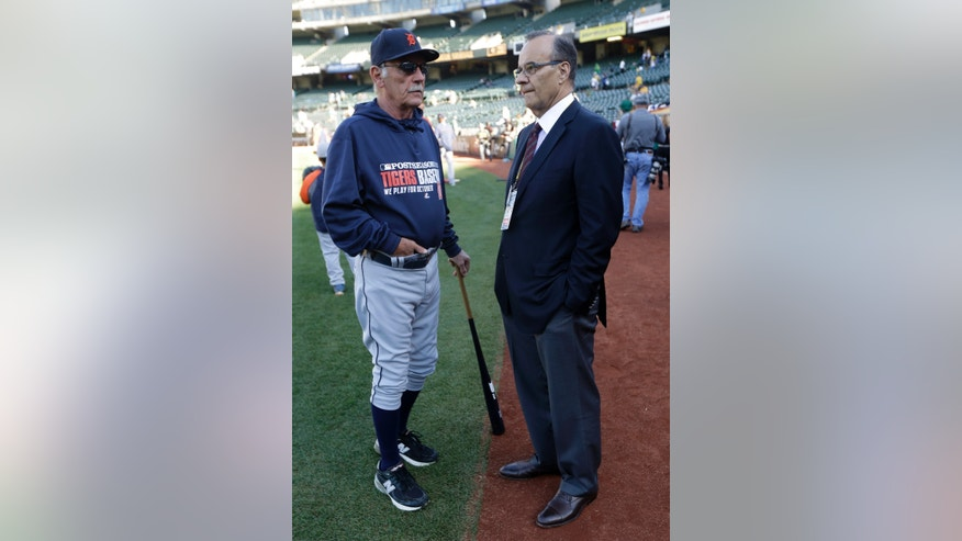 Major League Baseball executive Joe Torre, right, and Detroit Tigers manager Jim Leyland speak before Game 2 of the Tigers' American League  baseball Division Series against the Oakland Athletics, in Oakland, Calif., Saturday, Oct. 5, 2013. (AP Photo/Marcio Jose Sanchez)