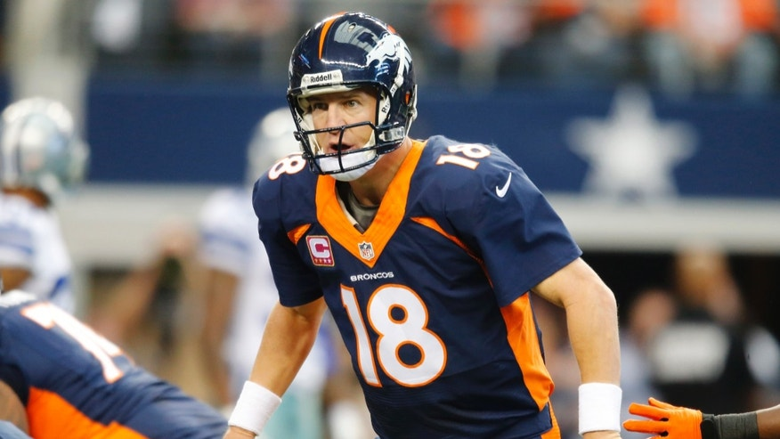 After passing the ball Denver Broncos quarterback Peyton Manning (18) watches as tight end Julius Thomas (80) scores a touchdown against the Dallas Cowboys during the first quarter of an NFL football game Sunday, Oct. 6,2013, in Arlington, Texas. (AP Photo/Sharon Ellman)
