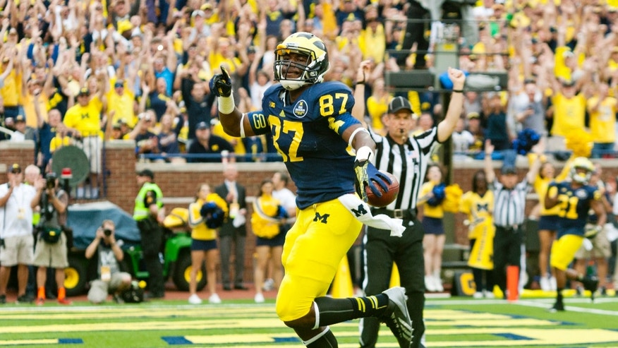 Michigan tight end Devin Funchess (87) scores a touchdown in the second quarter of an NCAA college football game against Minnesota, Saturday, Oct. 5, 2013, in Ann Arbor, Mich. (AP Photo/Tony Ding)
