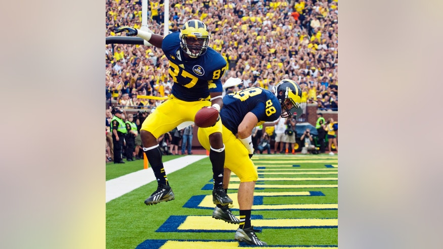 Michigan tight end Devin Funchess (87) celebrates his touchdown with tight end Jake Butt (88) in the second quarter of an NCAA college football game against Minnesota, Saturday, Oct. 5, 2013, in Ann Arbor, Mich. (AP Photo/Tony Ding)