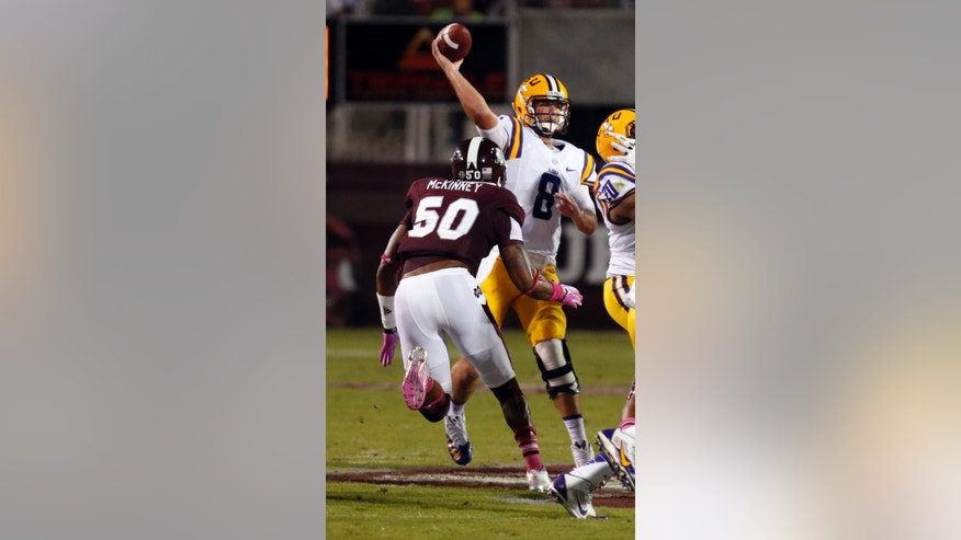 LSU quarterback Zach Mettenberger (8) throws a pass under pressure from Mississippi State linebacker Benardrick McKinney (50) in the first half of their NCAA college football game in Starkville, Miss., Saturday, Oct. 5, 2013.  (AP Photo/Rogelio V. Solis)