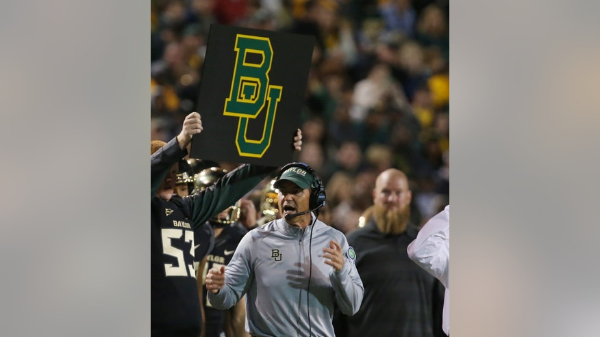 Baylor head football coach Art Briles checks on a play against West Virginia during the first half of an NCAA college football game on Saturday, Oct.  5, 2013, in Waco, Texas. (AP Photo/Rod Aydelotte)