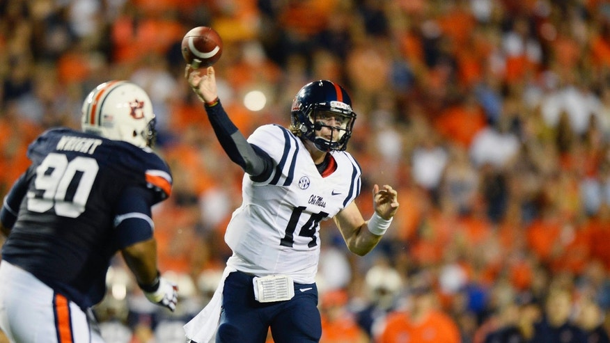 Mississippi quarterback Bo Wallace makes a throw against Auburn during the first half of an NCAA college football game on Saturday, Oct. 5, 2013, in Auburn, Ala. (AP Photo/Todd J. Van Emst)