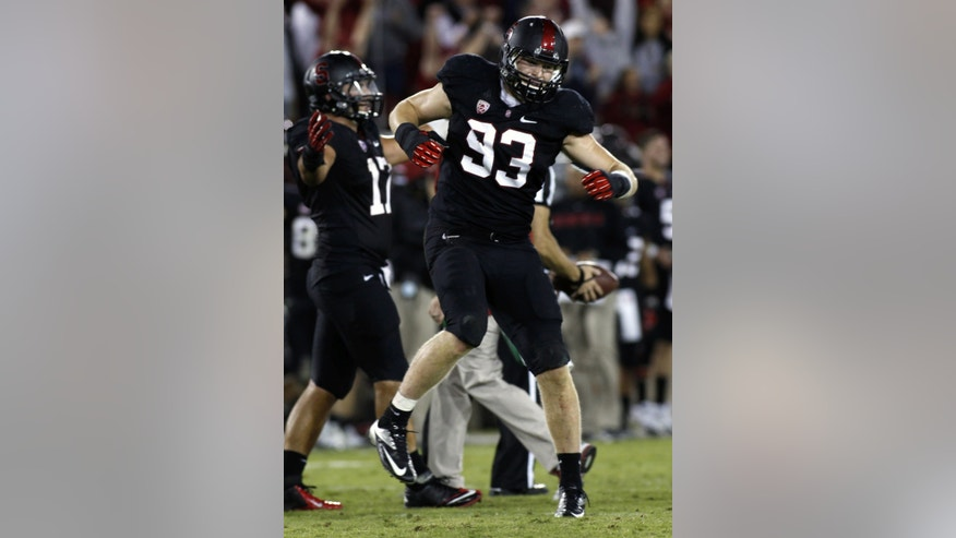 Stanford's Trent Murphy (93) celebrates near the end of an NCAA college football game against Washington, in Stanford, Calif., Saturday, Oct. 5, 2013. (AP Photo/George Nikitin)