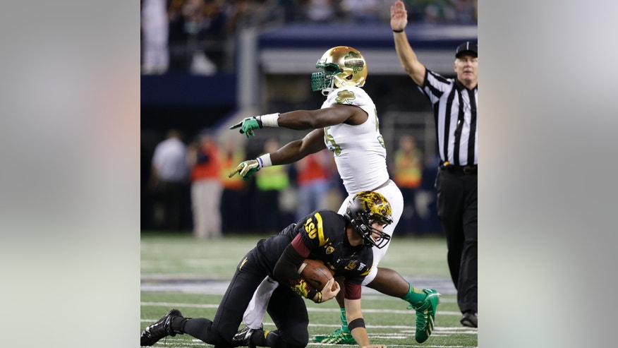 Notre Dame linebacker Prince Shembo celebrates sacking Arizona State quarterback Taylor Kelly during the second half of an NCAA college football game Saturday, Oct. 5, 2013, in Arlington, Texas. Notre Dame won 37-34. (AP Photo/LM Otero)