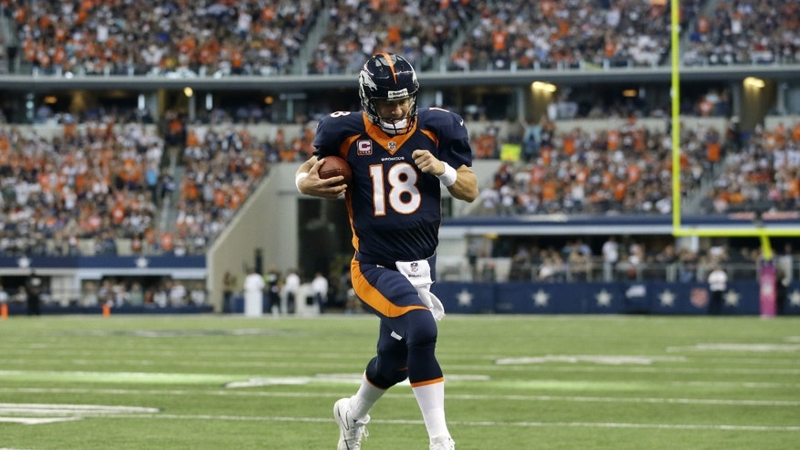 Denver Broncos quarterback Peyton Manning (18) sprints to the end zone untouched for a touchdown on a quarterback keep play in the first half of an NFL football game against the Dallas Cowboys, Sunday, Oct. 6,2013, in Arlington, Texas. (AP Photo/Tony Gutierrez)
