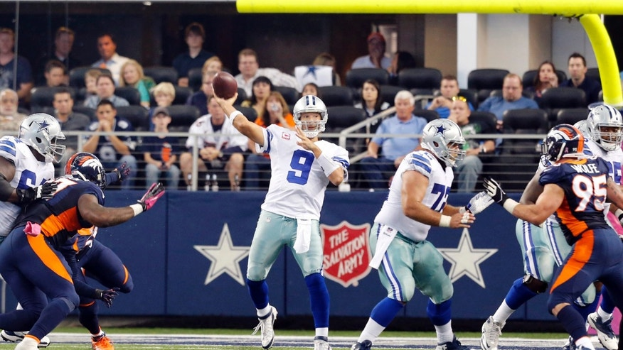 Dallas Cowboys quarterback Tony Romo (9) makes an 80-yard pass to wide receiver Dez Bryant against the Denver Broncos during the fourth quarter of an NFL football game Sunday, Oct. 6, 2013, in Arlington, Texas. Romo has 502 yards in passing. (AP Photo/Sharon Ellman)