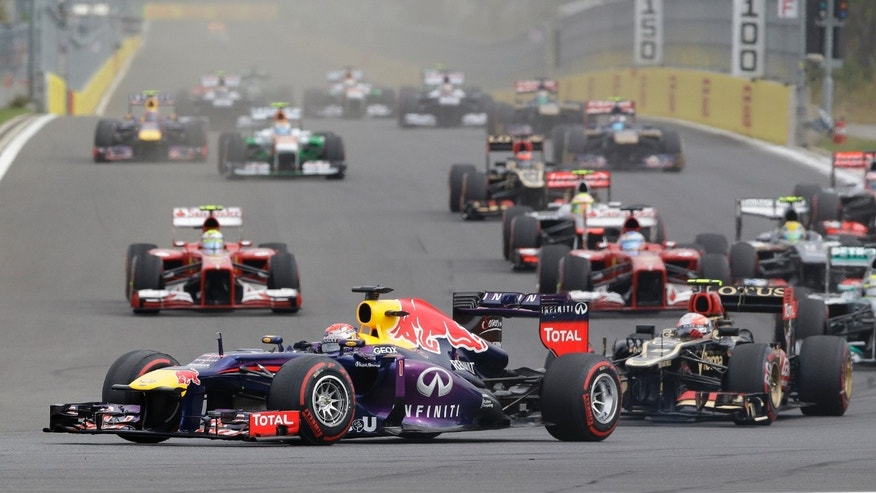 Red Bull driver Sebastian Vettel of Germany leads the field into turn three at the start of the Korean Formula One Grand Prix at the Korean International Circuit in Yeongam, South Korea, Sunday, Oct. 6, 2013. (AP Photo/Lee Jin-man)