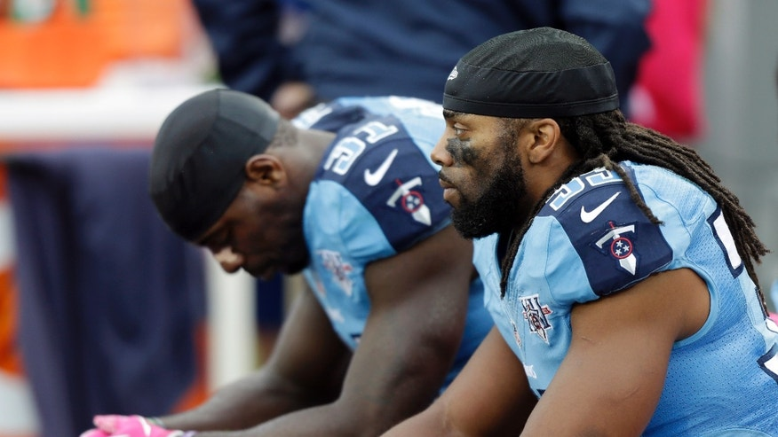 Tennessee Titans safety Michael Griffin (33) and safety Bernard Pollard (31) sit on the bench late in the fourth quarter of a 26-17 loss to the Kansas City Chiefs in an NFL football game on Sunday, Oct. 6, 2013, in Nashville, Tenn. (AP Photo/Wade Payne)