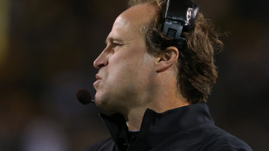 West Virginia head football coach Dana Holgorsen looks on against Baylor during the first half of an NCAA college football game Saturday, Oct.  5, 2013, in Waco, Texas. (AP Photo/Rod Aydelotte)