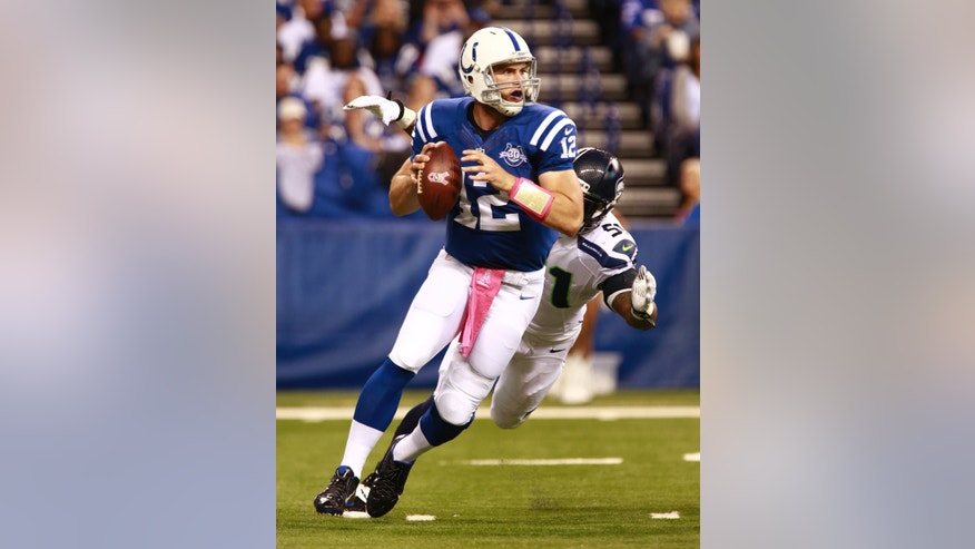 Indianapolis Colts quarterback Andrew Luck (12) is sacked by Seattle Seahawks defensive end Bruce Irvin during the first half of an NFL football game in Indianapolis, Sunday, Oct. 6, 2013. (AP Photo/Brent R. Smith)