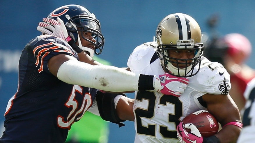 New Orleans Saints running back Pierre Thomas (23) rushes against Chicago Bears outside linebacker James Anderson (50) during the second half of an NFL football game, Sunday, Oct. 6, 2013, in Chicago.(AP Photo/Charles Rex Arbogast)
