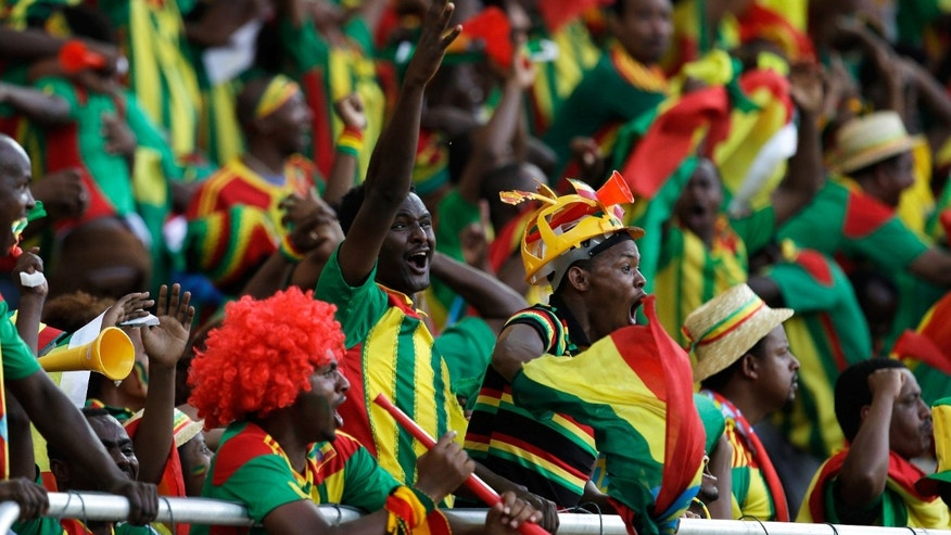 FILE - In this photo taken Monday, Jan. 21 2013, Ethiopian supporters celebrate a goal during a game against Zambia, during their African Cup of Nations tournament in Nelspruit, South Africa. After falling off the football map for thre decades Ethiopia is now just two games away from qualifying for the 2014 World Cup in Brazil. (AP Photo/Armando Franca, file)