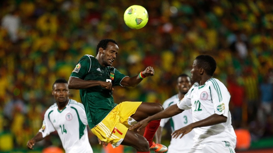 FILE - In this photo taken Tuesday, Jan. 29 2013 Ethiopia's Salahdin Said, center, heads the ball at Nigeria's goal during their African Cup of Nations group C match in  Rustenburg, South Africa. After falling off the football map for thre decades Ethiopia is now just two games away from qualifying for the 2014 World Cup in Brazil. (AP Photo/Armando Franca-file)