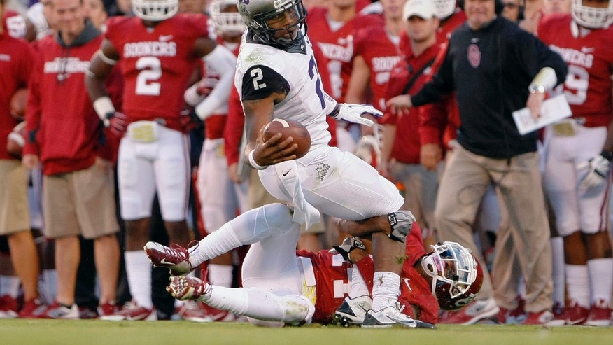 TCU quarterback Trevone Boykin (2) is sacked by an Oklahoma defender during the first half of an NCAA college football game on Saturday, Oct. 5, 2013, in Norman, Okla. (AP Photo/Alonzo Adams)