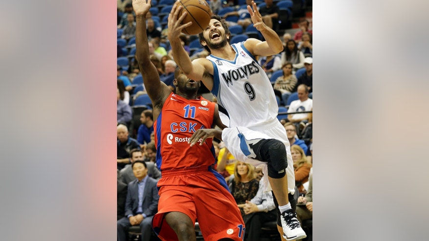 Minnesota Timberwolves' Ricky Rubio, right, of Spain, drives for a layup as CSKA Moscow's Jeremy Pargo defends in the first quarter of a preseason NBA basketball game, Monday, Oct. 7, 2013, in Minneapolis. (AP Photo/Jim Mone)